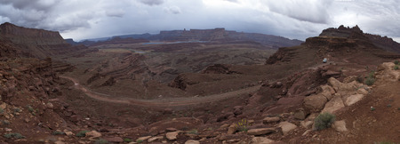 switchback: Dark Dramatic clouds and beautiful views from the Hurrah Pass Trail