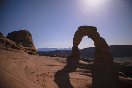 Long exposure night photography of famous landmark Delicate Arch - Arches National Park Moab Utah. photo