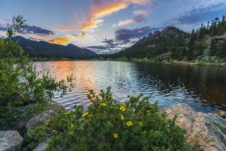 sunset lake: Beautiful sunset sky over Lily Lake - Rocky Mountain National Park Colorado
