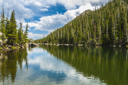 dream lake: Dream Lake dramatic sky reflection-Rocky Mountain Colorado Stock Photo