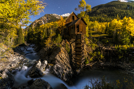 mill valley: Crystal Mill lid by a Moonlight with starry sky above, peak of the fall Gunnison Colorado