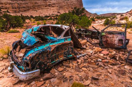 Abandoned Car wreck with bullet holes, Utah canyon