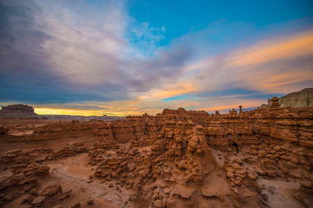 goblins: Birds eye view of the Goblin Valley at Sunset with colorful sky above Stock Photo