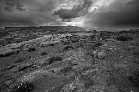 buildup: Rain Storm Clouds building up over the Desert Utah Landscape Stock Photo