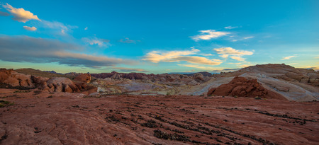 black pebbles: Fire Wave Panorama black pebbles, multicolored rock formations and blue sunset sky Stock Photo