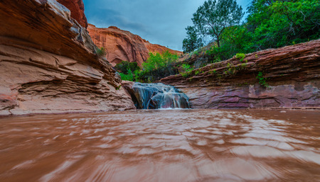 ie: Stock Photo - Waterfall in Coyote Gulch part of Grand Staircase Escalante National Monument in southern Utah canyon country low angle Stock Photo