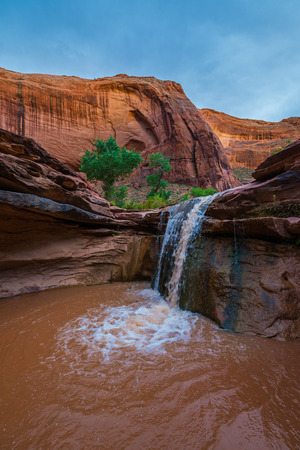 ie: Stock Photo - Waterfall in Coyote Gulch part of Grand Staircase Escalante National Monument in southern Utah canyon country