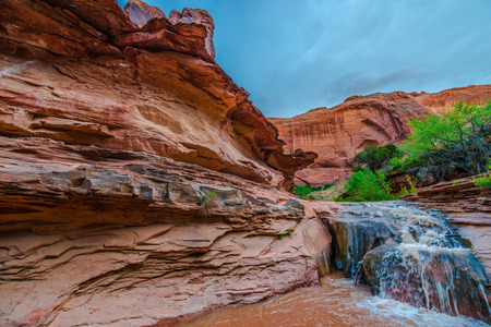 escalante: Stock Photo - Waterfall in Coyote Gulch part of Grand Staircase Escalante National Monument in southern Utah canyon country