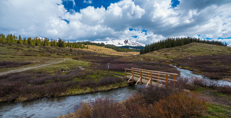 colorado rocky mountains: Creek and a foot bridge, Colorado Rocky Mountains Landscape