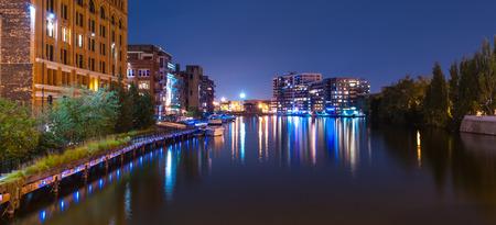 Milwaukee: Milwaukee River at night Buildings near the Milwaukee River Stock Photo