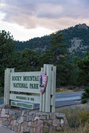 entrance sign: Rocky Mountain National Park Entrance Sign 100th Anniversary Stock Photo