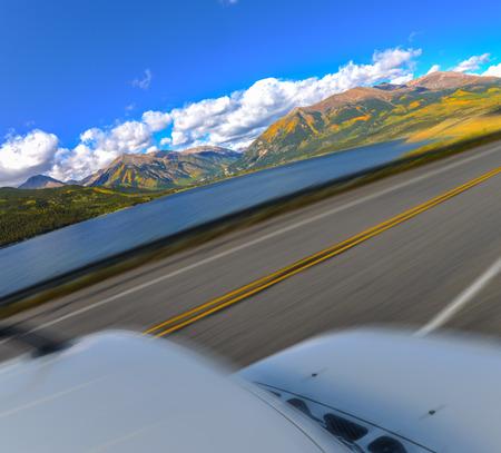 colorado rockies: Motion Blur White car on a Mountain Road i Colorado Rockies
