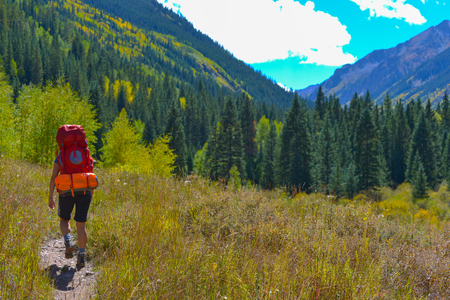conundrum: Backpacker hiking CONUNDRUM CREEK TRAIL near Aspen Colorado