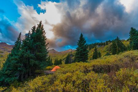 colorado rockies: Bright Orange Tent Conundrum Hot Springs Colorado Rockies