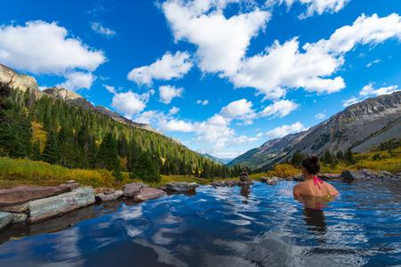conundrum: Woman relaxing in hot spring pool Conundrum Hot Springs near Aspen Colorado Stock Photo