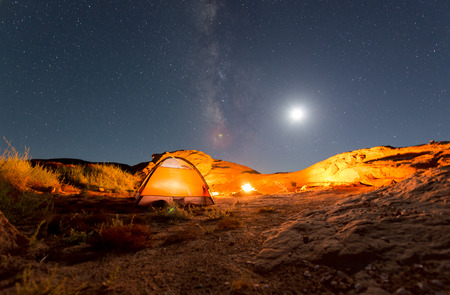camping: Beautiful Nigt Sky with Milky Way small tent and a camp fire red canyon Stock Photo