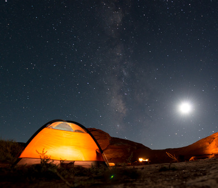 tent: Beautiful Nigt Sky with Milky Way small tent and a camp fire red canyon Stock Photo