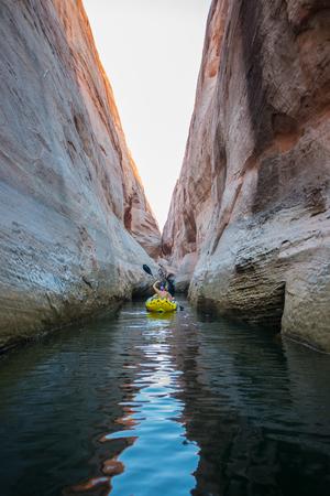 kayaker: Woman Kayaker Paddling in Lost Eden Canyon Lake Powell Utah