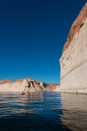 lost lake: Woman Kayaker Paddling in Lost Eden Canyon Lake Powell Utah