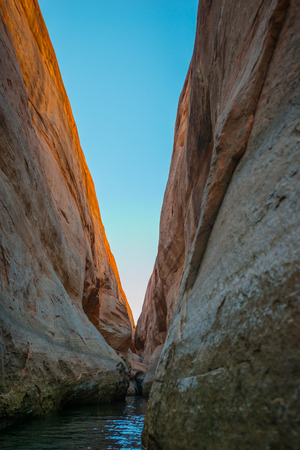 slot canyons: Calm Waters of Lake Powell in Narrow Slot Canyon near Lost Eden Stock Photo