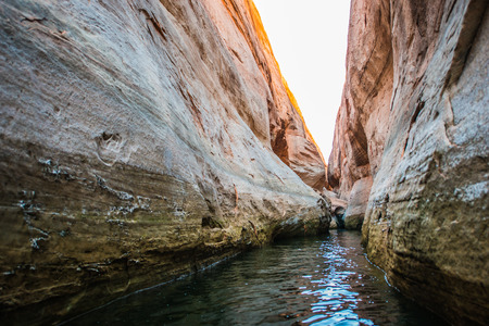 lost lake: Calm Waters of Lake Powell in Narrow Slot Canyon near Lost Eden Stock Photo