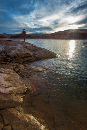 glen: Bikini Girl Looking at Sunset Glen Canyon Lake Powell Stock Photo