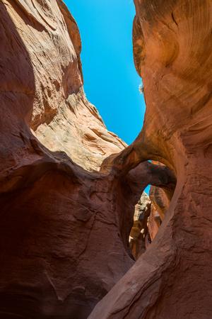peekaboo: Arches eroded in narrow, red sandstone Peekaboo Canyon Grand Staircase-Escalante