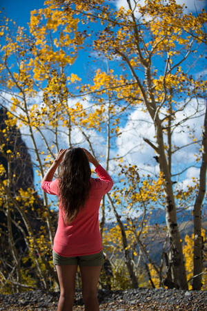colorado landscape: Woman Taking Picture of aspen tree Fall Colors Colorado Landscape Stock Photo