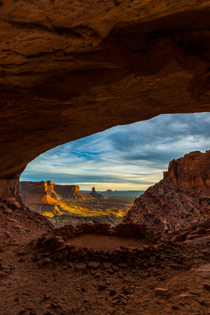 unexplored: Beautiful golden sunset light falling down the canyon, view from false kiva Canyonlands National Park near Moab Utah United States landscape USA Stock Photo