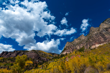 ouray: San Juan Mountains beautiful blue sky and vibrant autumn colors Colorado Landscape