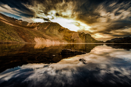 ouray: Dramatic Clouds Reflection in Crystal Lake, at the top of 11,789 foot Ophir Pass, Stock Photo
