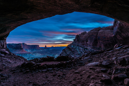 canyonland: Vibrant Sunset Colors view from the inside of the False Kiva Canyonlands National Park Moab Utah United States Landscape USA Stock Photo
