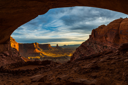kiva: Beautiful golden sunset light falling down the canyon, view from false kiva Canyonlands National Park near Moab Utah United States landscape USA Stock Photo