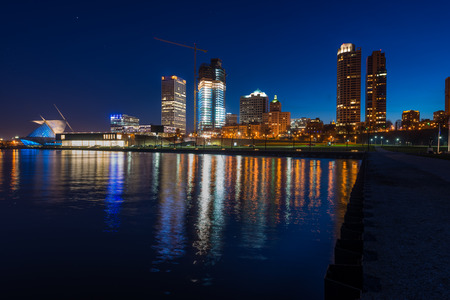 lakefront: City of Milwaukee Wisconsin at Night lakefront ligts reflection in lake Michigan Stock Photo