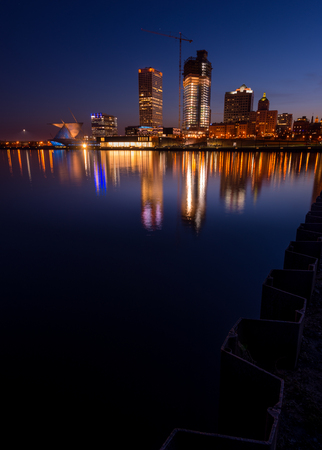 Milwaukee: City of Milwaukee Wisconsin at Night vertical composition Stock Photo