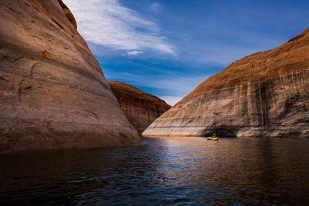kayaker: Girl Kayaker exploring beautiful lake Powell Utah-Arizona USA