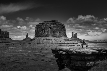 Monument Valley Young Woman Horseback Riding at Johns Ford Point Stock Photo