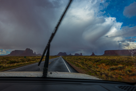 monument valley view: View from inside the car towards the Forrest Gump Point Monument Valley Stock Photo
