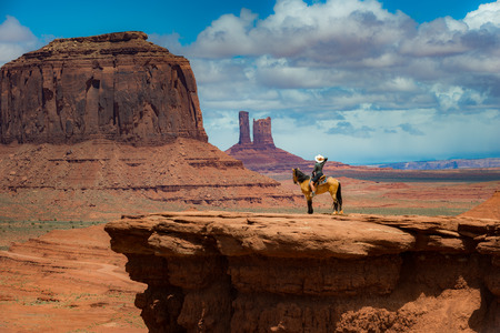 tribal park: Monument Valley Young Woman Horseback Riding at Johns Ford Point Stock Photo