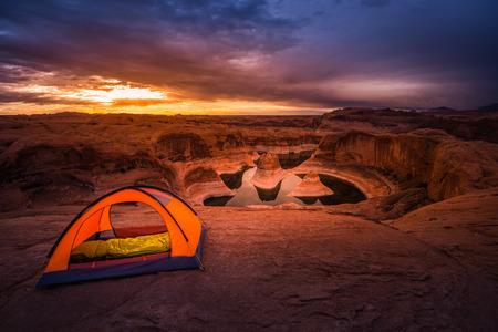 campsite: Small Orange Tent Lake Powell Reflection Canyon Beautiful Sunrise USA Travel Stock Photo