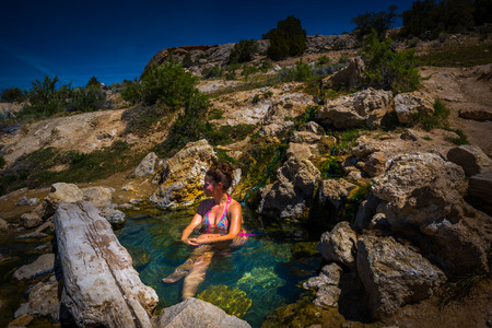 sierras: Woman relaxing in Travertine Hot Spring pool Bridgeport California USA Stock Photo
