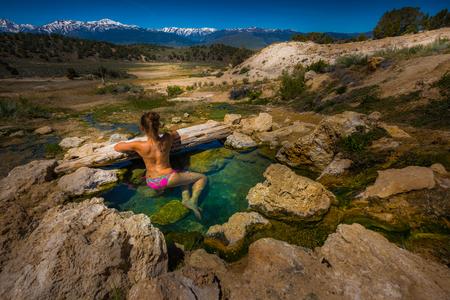 Woman relaxing in Travertine Hot Spring pool Bridgeport California USA Stock Photo