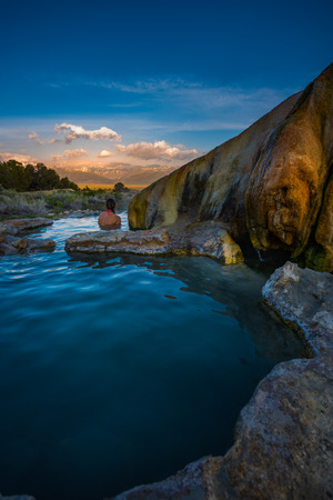 Woman relaxes in Travertine Hot Springs California USA
