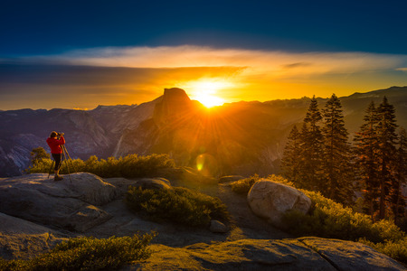 Yosemite National Park Woman Photographer taking pictures at Sunrise from the Glacier Point