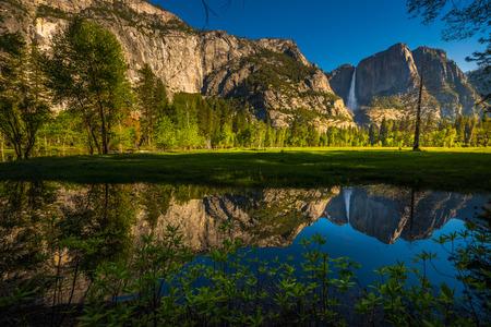 merced: Yosemite Falls reflection in Merced River at Sunrise National Park, California