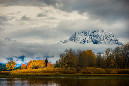 oxbow: Autumn in the Tetons Beautiful fall colors and thick white clouds