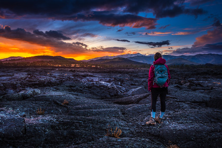 Hiker Backpacker on a trail Craters of The Moon National Monument Idaho  Stock Photo