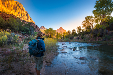 Backpacker exploring Zion National Park near the virgin river Stock Photo