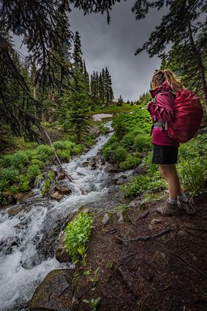 indian creek: Girl Hiker about to cross creek,  Indian Peaks Wilderness  Stock Photo