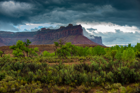 Needles District of the Canyonlands Landscape Cliffs covered in stormy clouds Utah USA